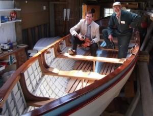 27 foot Montague Whaler being restored - Colin King checking Bills progress