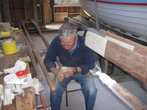 Ken busy sanding and varnishing oars